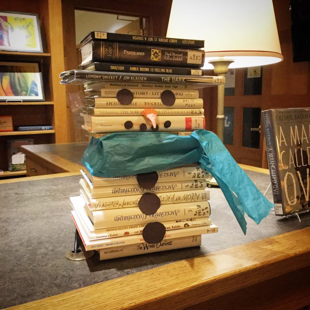 These cold days bring the return of the book snowman at Ohrstrom Library - visit him at the front desk next time you stop by! #ohrstromlibrary #snowman #booksnowman #books #bookdisplay #librarydisplay #librariesofinstagram #frosty #coldday #iamsps